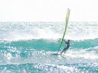 boy windsurfing in the sea