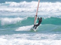 catching the waves while windsurfea