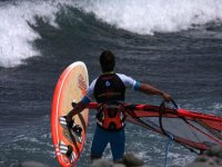 entering the sea to practice windsurfing