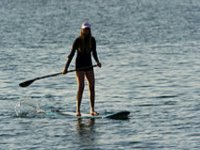 girl in the shadows practicing sup