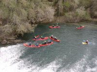 enjoying a canoe ride through whitewater