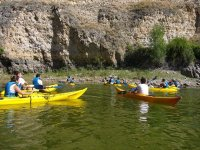 group of friends in canoes