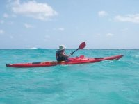 person navigating the sea in canoe