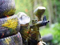 behind some wheels playing paintball.jpg