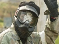 painting in the helmet of a paintball player
