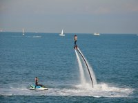 Flyboard in front of boats