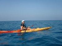 Self-emptying kayak