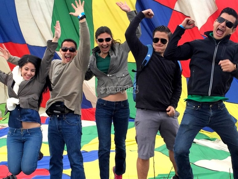 Friends jumping in the hot air balloon