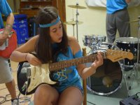 Playing the guitar at Camp Rock