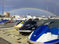 A rainbow behind the jet skis