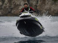 Riding the waves on board a jet ski