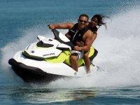 Jet ski as a couple on the beach