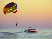 Flying over the sea in parasailing