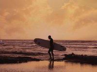 Bono de clases de surf en la playa de las Américas