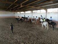 Horse riding class on the indoor track
