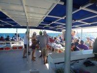Chatting on the catamaran on the Alicante coast