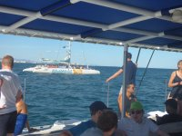 Watching the catamaran from the boat in the Mediterranean