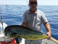 Pescador con dorado