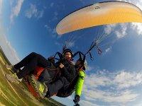 Tandem paraglider flying in Portugal