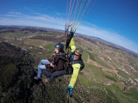 Paragliding instructor with passenger in Portugal