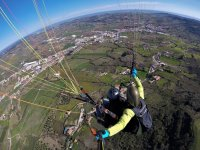 Paragliding flying over Portugal