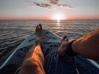Paddle surf at sunset