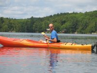 man in a kayak in nature