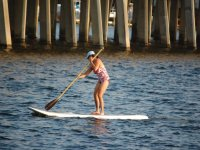 girl paddling on a sup board