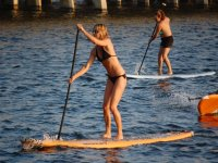 two girls practicing sup