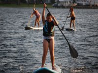 mother and daughters practicing sup