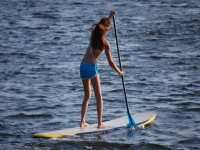 paddle surfing surf
