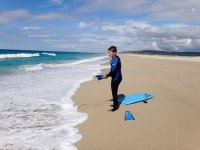 child with surf equipment