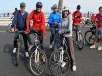 group of friends with bicycles on the road