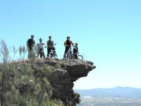 At the edge of the cliff, by mountain bike