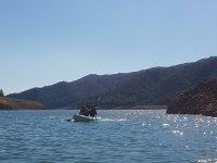 Sharing kayak in the reservoir