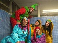 Monitors dressed as elves