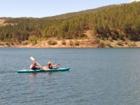 Riding in a canoe El Vado reservoir