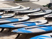 sup tables with oars in the sand