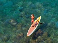 Girl sailing with a SUP surfboard