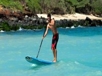 Youngster practicing SUP in Girona
