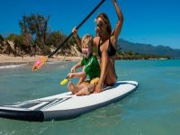 Mother and child sailing with a Paddle Surf surfboard