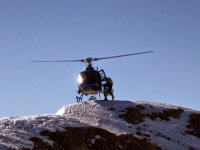 Helicopter on a snowy peak
