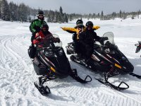 On a snowmobile as a couple