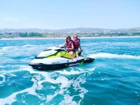 Girls on jet skis in the Maresme