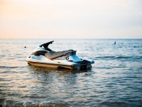 Jet ski with the sunset in the beach