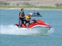 Passenger standing on the jet ski