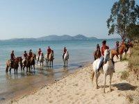 Por la playa a caballo