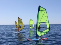 learning windsurfing in calm waters