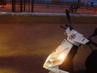 On the beach with the night motorcycle