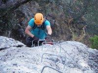 Climbing up the ferrata staples in Malaga